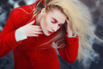 Portrait attractive blonde with eyes closed outdoors