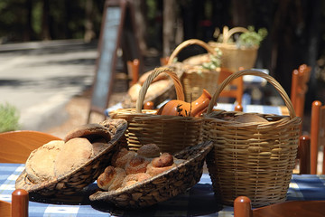 still life of bread and dishes in an outdoor cafe