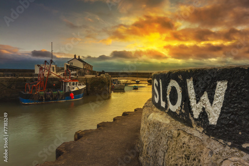 Fishing boats hunker down in Lyme Regis harbour