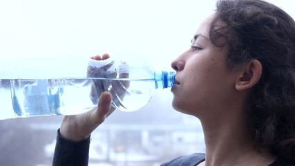young girl drinking water close up