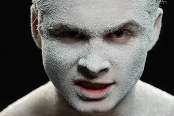 Handsome man with a white powder on the face