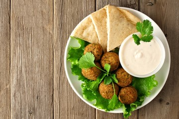 Plate of falafel with pita bread and tzatziki sauce