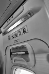 Italy, airplane cabine, emergency exit light