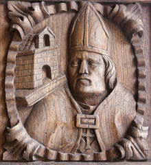 Wooden engraving of a bishop at the main door of Tui Cathedral