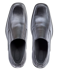 Modern black leather shoes, no shoe string, top view isolated on
