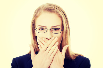 Beautiful business woman is covering her mouth.