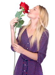 Smelling beautiful red rose