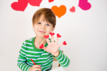 Child Holding Valentine's Day Hearts