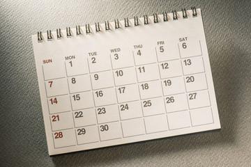 Calendar.On desk.