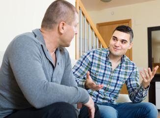Conversation between two men indoor