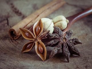 cinnamon sticks and star anise on rustic wood background