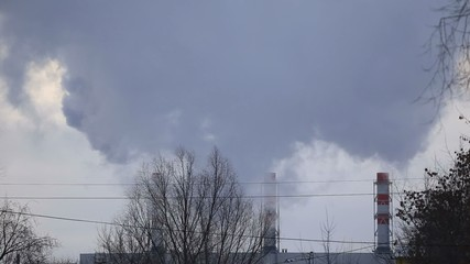 The smoke comes from the chimneys in winter, three pipes