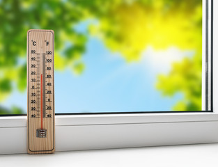 thermometer on the windowsill on the background of the summer he