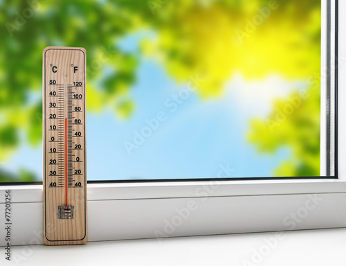 thermometer on the windowsill on the background of the summer he - 77203256