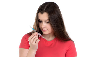 Teenager looking at syringe