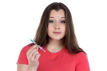 Teenage girl holding the syringe