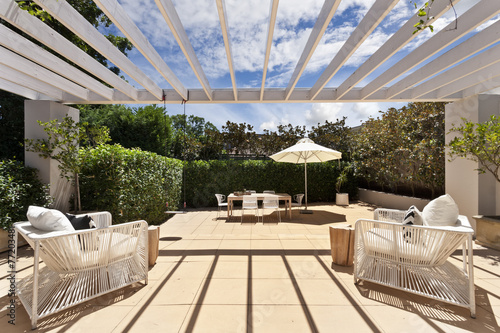 Foto op Plexiglas Industrial geb. backyard cozy patio area with wicker furniture set