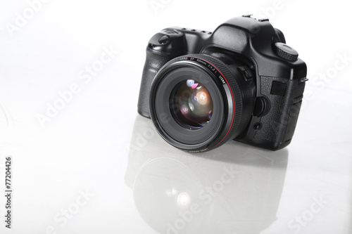 The camera on white background - 77204426