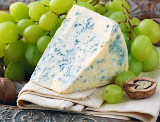 piece of blue cheese with fruits and herbs