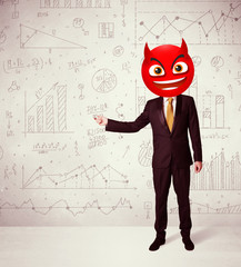 businessman wears devil smiley face