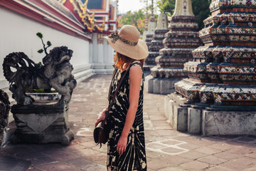 Woman exploring buddhist temple