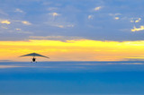 motor hang glider in the cloudy sunset