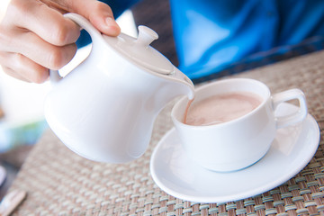 pouring coffee into coffee cup