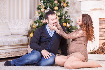 Pregnant couple sitting on the floor