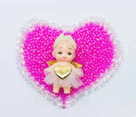 Cupid on the center on crystal and beads valentine hearts
