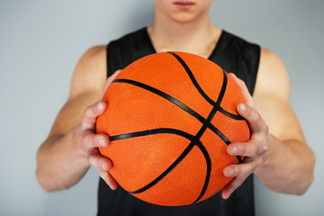 Close-up photo of ball in sportsman hands