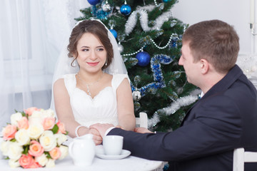 Bride and groom at the table