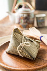 Zongzi or sticky rice dumpling with tea