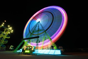 Abstract blurry background in amusement fair at night