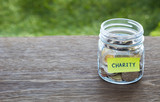 Charity donation money glass jar