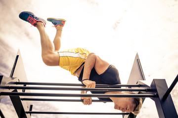 Athlete training at bar