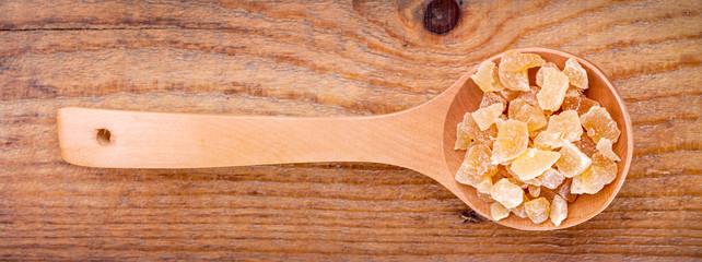 dried mango  in wooden spoon