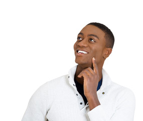 handsome happy man thinking looking up white background