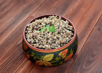Buckwheat groats in a wooden bowl