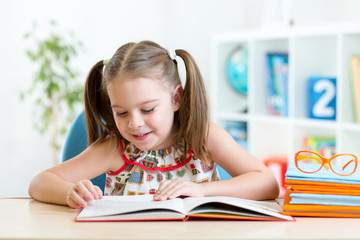 Kid girl learns to read book