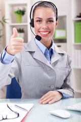 beautiful Support phone operator in headset at workplace