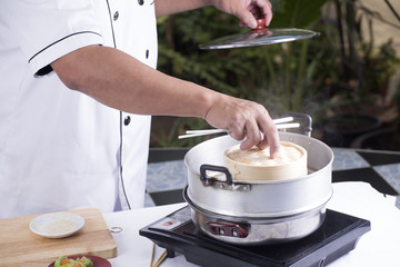 chef opening lid of basket bamboo