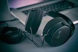 Hi-Fi headphones on a laptop in the studio