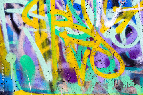 Colorful graffiti wall with spray paint