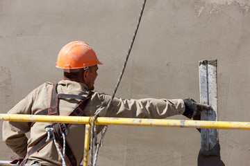 Plastering facade works with trowel tool