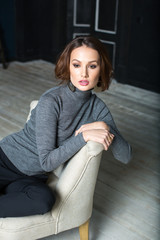 Winter fashion beauty girl in turtleneck and pants