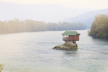 house on river