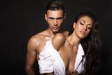 sexy beautiful couple posing in dark studio
