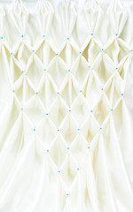 white satin folded pattern fabric art