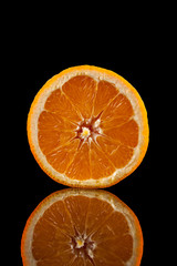.Orange fruit isolated on a black background