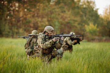 soldiers shoot at the enemy